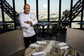 "In this file photo taken on July 15, 2019 starred French chef Frederic Anton poses during a photo session at the ""Le Jules Verne"" restaurant at the Effeil Tower in Paris on July 15, 2019."