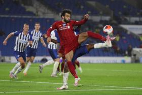 Mohamed Salah's two goals against Brighton helped him go closer to Leicester City's Jamie Vardy, who is leading the race for the Golden Boot award.