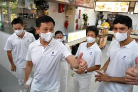 Education Minister Ong Ye Kung responding to a resident with a thumbs up during a walkabout at a coffee shop in Sembawang Drive on 1 July 2020. Mr Ong is helming the People's Action Party (PAP) team contesting in Sembawang GRC, which also includes (from left) Dr Lim Wee Kiak, Ms Mariam Jaafar, Ms Poh Li San and Mr Vikram Nair.