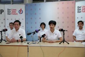PAP's Tanjong Pagar GRC team, Chan Chun Sing talks to the media at PAP's Buona Vista Branch headquarters on July 11, 2020. With him are his team mates Indranee Rajah, Joan Pereira, Alvin Tan and Eric Chua.