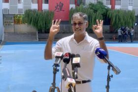 The People's Action Party's Murali Pillai gives a doorstop interview at the nomination centre at Nan Hua High School.
