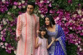Indian film actor Abhishek Bachchan, his wife Aishwarya Rai and their daughter Aaradhya in a 2019 photograph taken at the wedding of Akash Ambani, the son of Reliance Industries chairman Mukesh Ambani, in Mumbai, India. Picture taken on March 9, 2019.