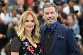 "In this file photo taken on May 15, 2018 US actor John Travolta (R) and his wife US actress Kelly Preston pose during a photocall for the film ""Gotti"" at the 71st edition of the Cannes Film Festival in Cannes, southern France."