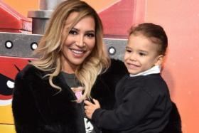 """In this file photo US actress Naya Rivera and son Josey Hollis Dorsey arrive for the premiere of """"The Lego Movie 2: The Second Part"""" at the Regency Village theatre on February 2, 2019 in Westwood, California."""