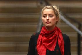 Actress Amber Heard leaves the High Court in London, Britain July 15, 2020.