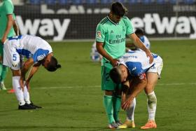 Real Madrid midfielder Marco Asensio comforting Leganes defender Unai Bustinza after their match ended in a 2-2 draw that consigned Leganes to the Segunda.