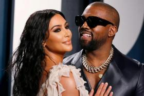 Kim Kardashian and Kanye West attend the Vanity Fair Oscar party in Beverly Hills during the 92nd Academy Awards, in Los Angeles, California, U.S., February 9, 2020.