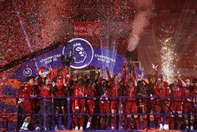 Reds fans relieved they got to watch team lift EPL trophy on StarHub
