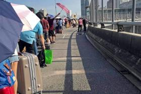 Pictures widely shared on social media sites yesterday showed people queueing to cross the Causeway to Malaysia.
