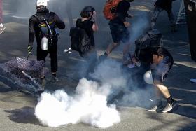 Seattle Black Lives Matter clashes spark arrests, policemen injured