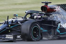 Lucky Lewis Hamilton limps to victory on three tyres