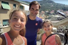 Rooftop tennis girls get pleasant surprise as Federer pays a visit
