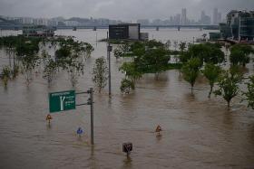 South Korea battles both virus and floods