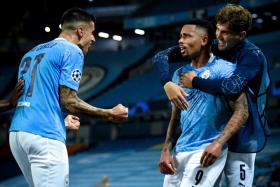 Gabriel Jesus (centre) celebrates after scoring Manchester City's second goal.