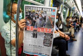 Hong Kong's Apple Daily vows to 'fight on' after owner's arrest