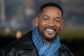 In this file photo taken on January 06, 2020 US actors Will Smith poses at the 'Bad Boys For Life' launching photocall in Paris, in front of the Eiffel Tower.