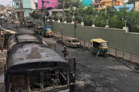 Three die in Bengaluru as Facebook post sparks clashes with police