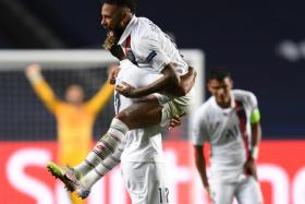 Neymar celebrates with Eric Choupo-Moting after Paris Saint-Germain's 2-1 victory over Atalanta.