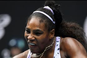 Serena Williams rallies in return, sets up clash with sister Venus