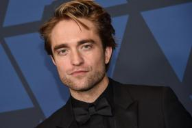 In this file photo taken on October 27, 2019 British actor Robert Pattinson arrives to attend the 11th Annual Governors Awards gala hosted by the Academy of Motion Picture Arts and Sciences at the Dolby Theater in Hollywood.