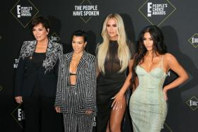 In this file photo taken on November 10, 2019 (L-R) Business women/media personality Kris Jenner, Kourtney Kardashian, Khloé Kardashian and Kim Kardashian arrive for the 45th annual E! People's Choice Awards at Barker Hangar in Santa Monica, California.
