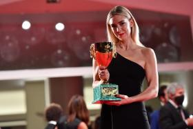 British actress Vanessa Kirby holds the Volpi Cup (Coppa Volpi) Award for Best Actress for her performance in the movie 'Pieces of a Woman' during the awarding ceremony of the 77th annual Venice International Film Festival, in Venice, Italy, 12 September 2020.