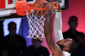 LeBron James dunking the ball en route to his tally of 29 points against the Houston Rockets.