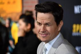 """In this file photo taken on February 27, 2020 US actor Mark Wahlberg arrives for the premiere of Netflix's """"Spenser Confidential"""" at Regency Village Theatre in Westwood, California."""