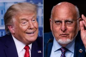 US President Donald Trump disputed Dr Robert Redfield's (right) testimony at a congressional committee hearing.