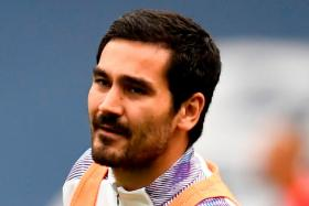 Midfielder Ilkay Guendogan (above) becomes the third Manchester City player to contract Covid-19, after winger Riyad Mahrez and defender Aymeric Laporte previously tested positive earlier this month.