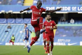 Sadio Mane celebrates after scoring Liverpool's second goal.