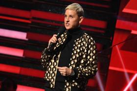 In this file photo taken on January 26, 2020 US comedian Ellen DeGeneres introduces Lil Nas X and Billy Ray Cyrus during the 62nd Annual Grammy Awardsin Los Angeles