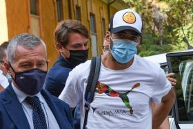 Luis Suarez (right) arriving at Perugia's University in Italy last week.