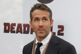 """Actor Ryan Reynolds poses on the red carpet during the premiere of """"Deadpool 2"""" in Manhattan, New York, U.S., May 14, 2018."""