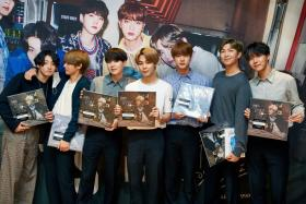 A handout photo made available by MBC on 15 September 2020, shows members of K-pop group BTS appearing on the network's radio program 'Bae Chul-soo's Music Camp' on 14 September 2020, in Seoul, South Korea.