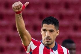 Striker Luis Suarez, who moved to Atletico Madrid from Barcelona only on Friday, started on the bench against Granada on Sunday.