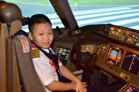 Huo Xi Cheng, who suffers from acute myeloid leukaemia, had his wish granted by Make-A-Wish Singapore. The 13-year-old was able to pilot a plane in a simulator in 2016 when he visited the Temasek Aviation Academy (TAA) to test TAA's newest private jet