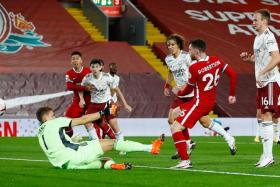 Andy Roberton scoring Liverpool's second goal.
