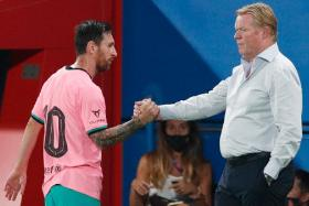 Barcelona coach Ronald Koeman (right) and his captain Lionel Messi have had a positive start to their La Liga campaign, following a 4-0 drubbing of Villarreal on Sunday.