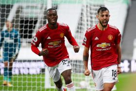 Bruno Fernandes (right) celebrates with Aaron Wan-Bissaka after scoring Manchester United's second goal.