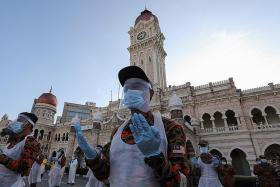 Malaysia reports record 871 coronavirus cases