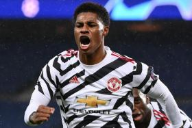Manchester United forward Marcus Rashford celebrating after bagging the winner in his side's 2-1 victory away to Paris Saint-Germain in the Champions League.