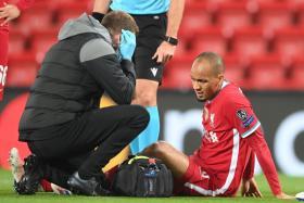 Fabinho joins Virgil van Dijk and Joel Matip in the treatment room after picking up a hamstring injury.