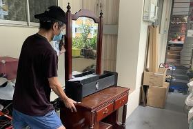 Man blocks neighbour's corridor with dresser over flower pot dispute