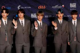 Members of South Korean boy band TXT pose on the red carpet during the annual MAMA Awards at Nagoya Dome in Nagoya, Japan, December 4, 2019.