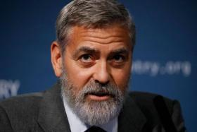 In this file photo taken on September 19, 2019 US actor George Clooney takes part in a press conference in central London to present a report on atrocities in South Sudan.