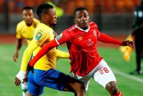 Mamelodi Sundowns defender Motjeka Madisha (left) won 12 caps for South Africa.
