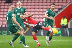 Nathan Redmond (in red) scoring Southampton's third goal against Sheffield United.