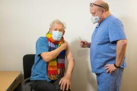 Actor Ian McKellen looks on as he receives the Pfizer-BioNTech COVID-19 vaccine from GP Dr Phil Bennett-Richards at the Arts Research Centre, Queen Mary University Hospital, in London, Britain December 16, 2020.