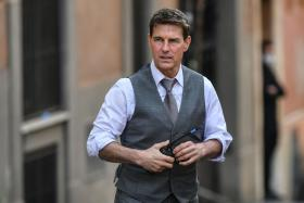 """US actor Tom Cruise is pictured during the filming of """"Mission Impossible : Lybra"""" on October 6, 2020 in Rome."""